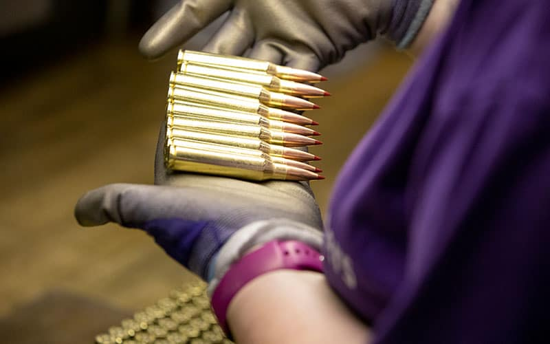 Hornady worker inspects rifle ammunition for quality control